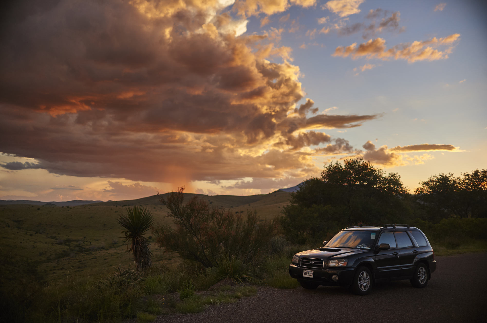 """Part of my """"Most Beautiful Parking Lots"""" Series. Subaru Forester XT in front of a sunset."""