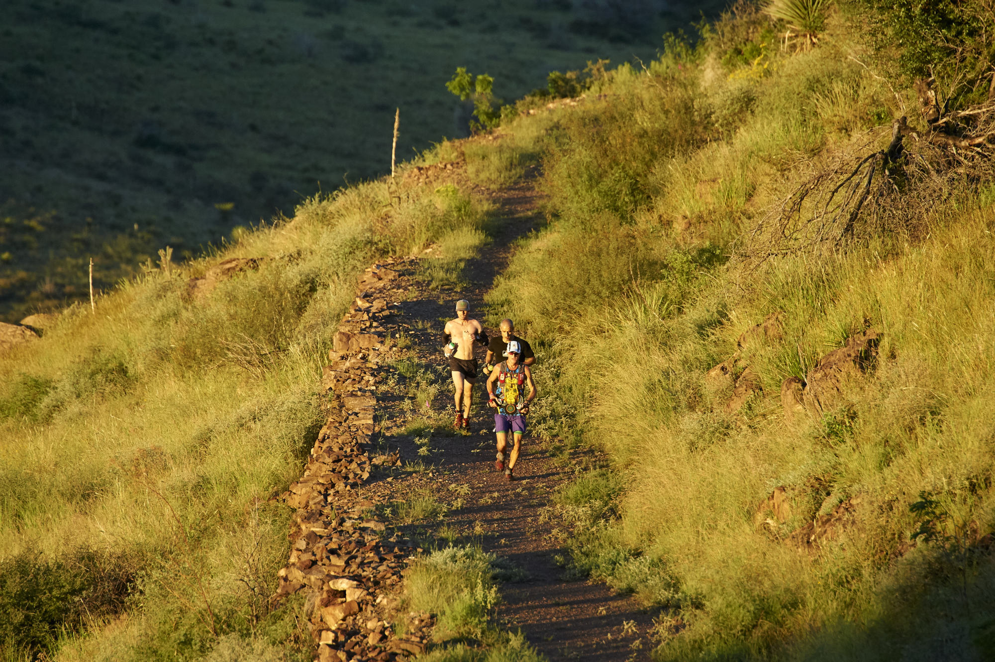 The first runners in the Spectrum Trail Race make their way up onto the ridge.