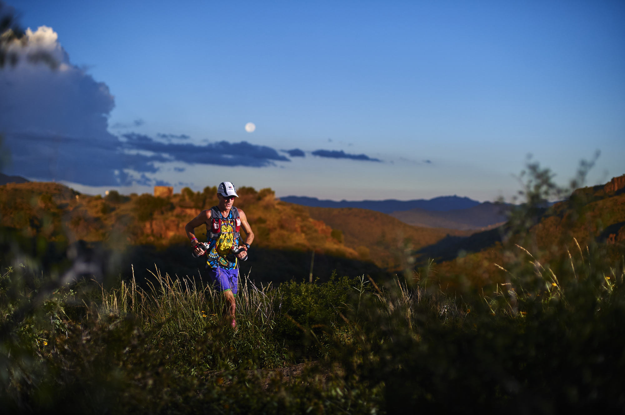 A trail runner passes my position at sunrise along the ridge in the Davis Mountains.