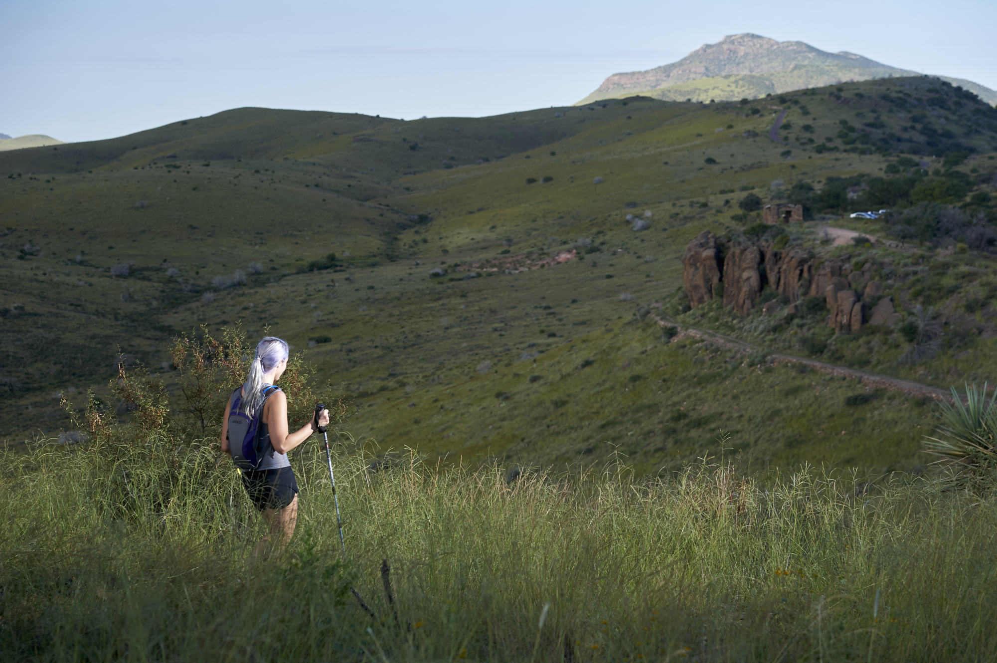 A runner pauses to appreciate the view from the top of the ridge during the race.