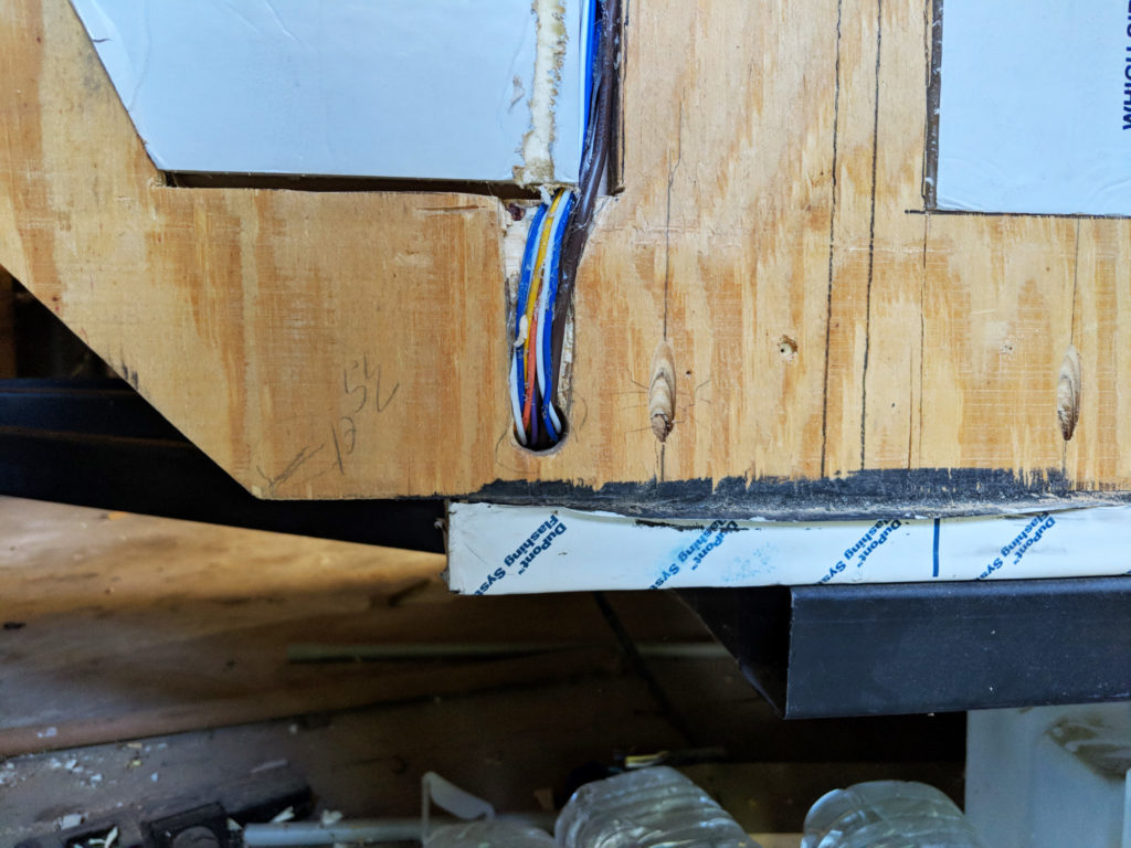 Teardrop lower front intersection of wall floor and trailer.