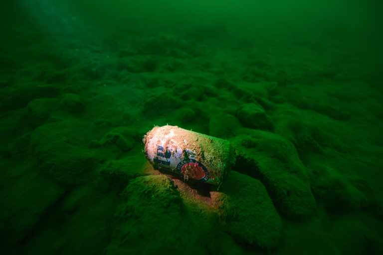 Miller Late - A beer can sits on the bottom of lake Travis.