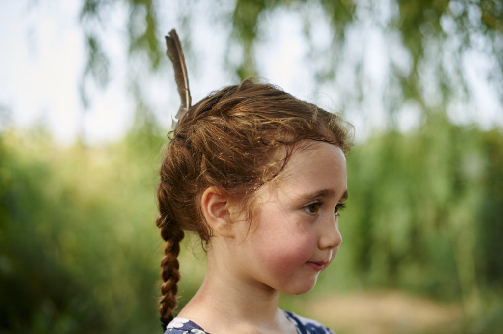 The Wonder of Children with a Feather in Her Hair