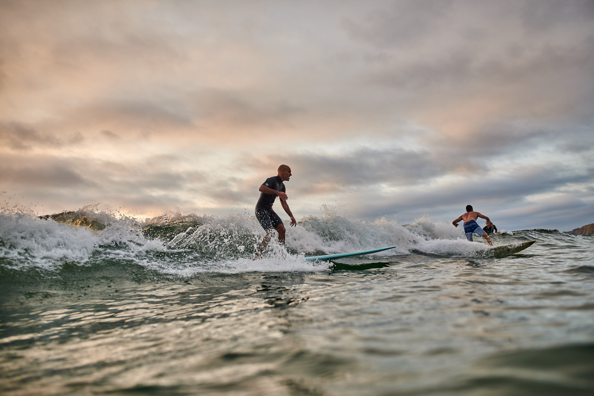 La Jolla Scripts Pier Surfing at Sunset - Photo from in the water.
