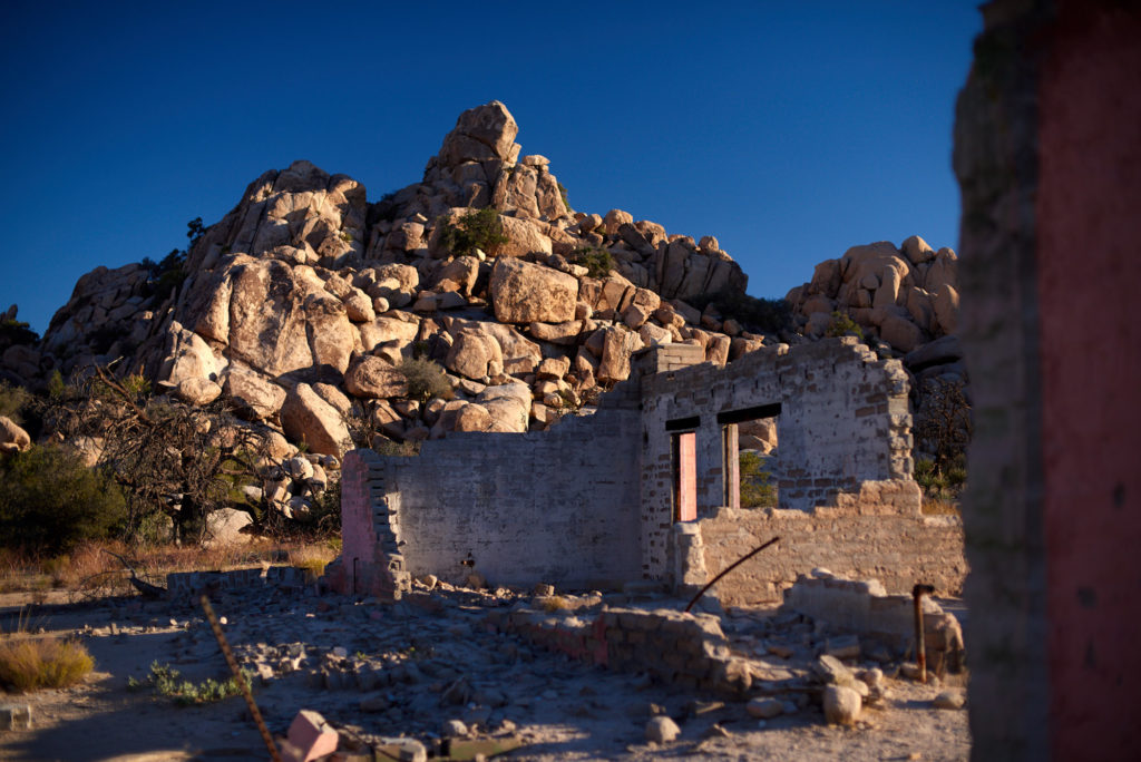 Remains of the Ohlson House nestled along the edge of the wonderland of rocks at Joshua Tree national park.