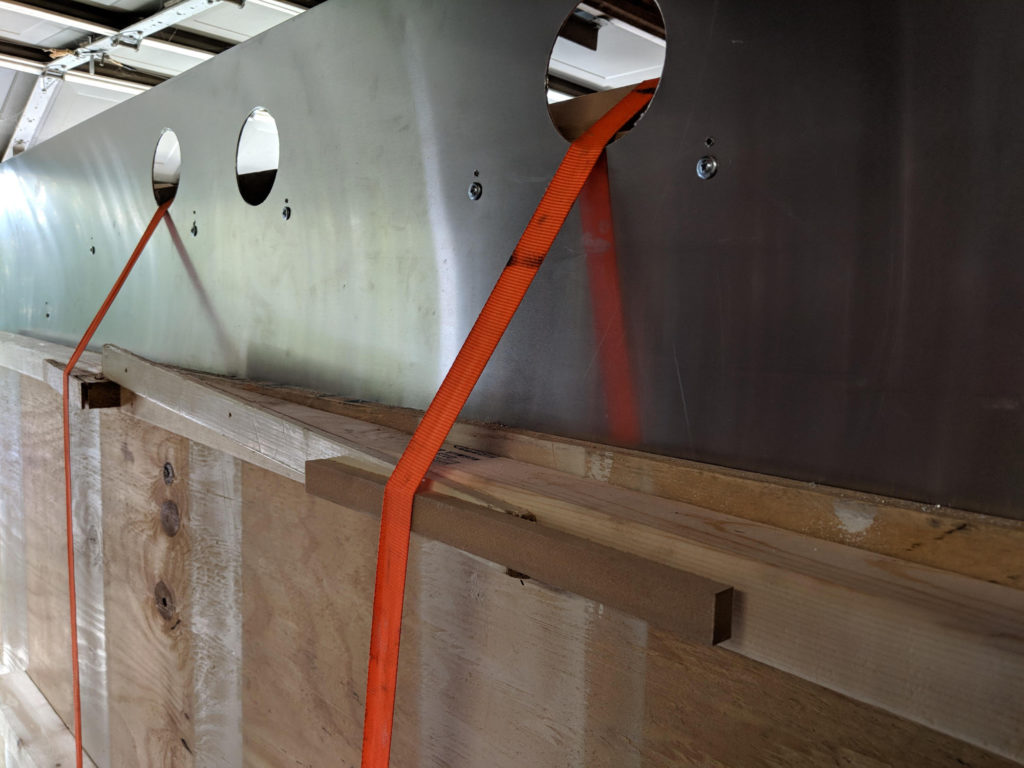 Strap clamps running over the top of the trailer to pull the middle top of the siding against the wall.