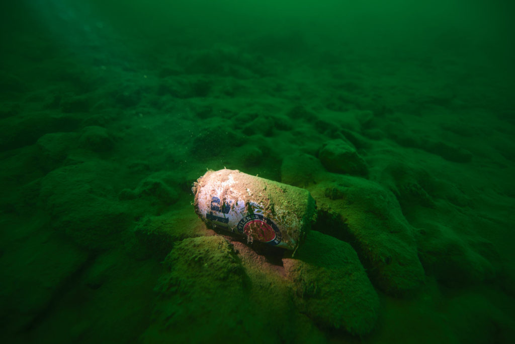 A miller-lite can on the bottom of lake travis.