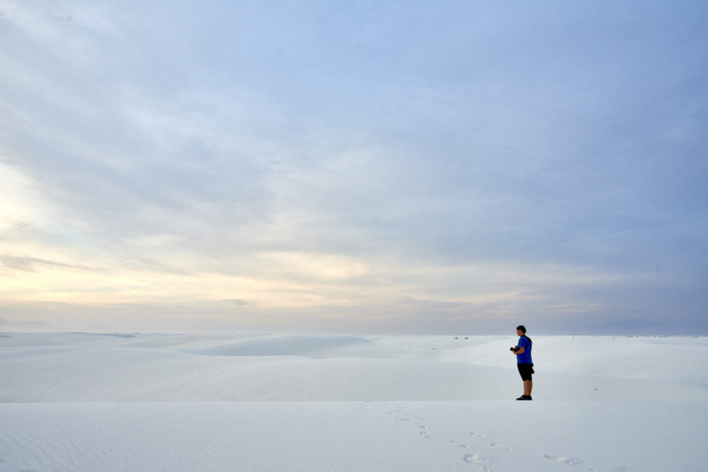 A photographer at White Sands.