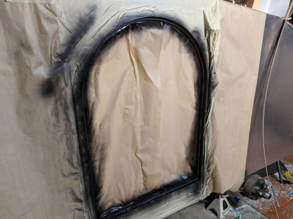 Teardrop - Sealing the door jam edges with paint.