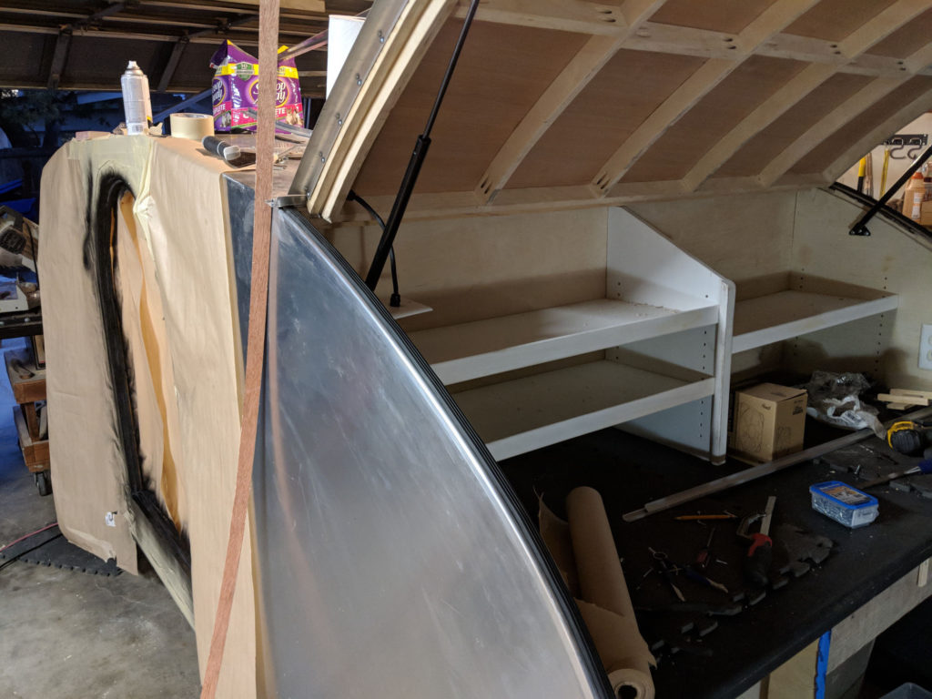 Teardrop camper - rear hatch strut and finished rear edge wall.