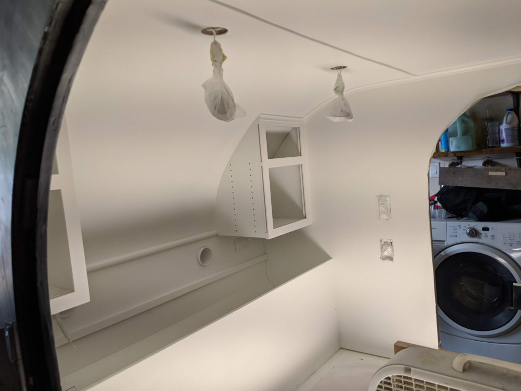 Teardrop camper interior sprayed with a semi-gloss white paint.