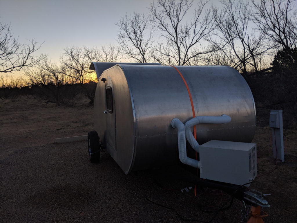 Teardrop in front of sunset at Caprock Canyon. Note installed exterior edge trim.