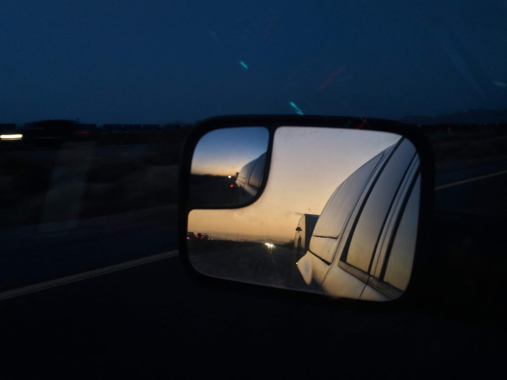 Sunset in my rear view mirror while towing the teardrop camper.