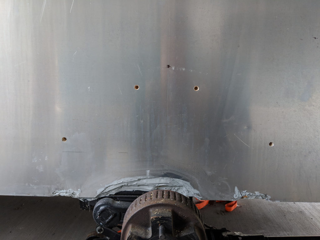 Holes marked and drilled in the side of the teardrop trailer for the new fender mounting.