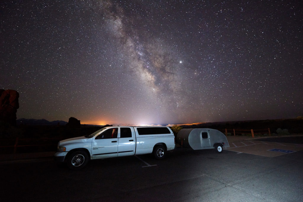2005 Dodge Ram towing my home built teardrop camper under the milky way at Arches National Park.