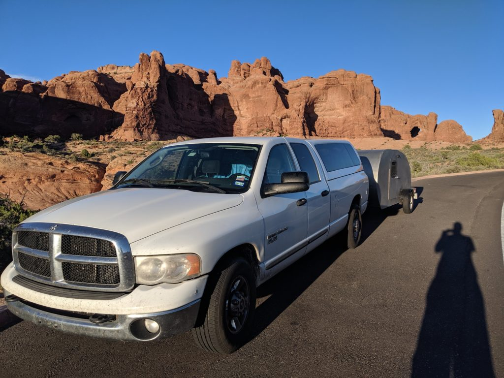 Dodge Truck towing home built teardrop camper through Arches National Park.